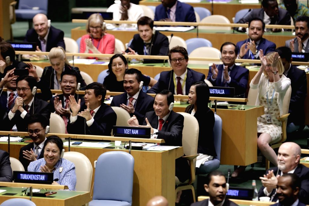 UNITED NATIONS, June 7, 2019 - Vietnamese Deputy Minister of Foreign Affairs Le Hoai Trung (1st R, 3rd row) celebrates with his delegation after his country was elected one of the five non-permanent ...