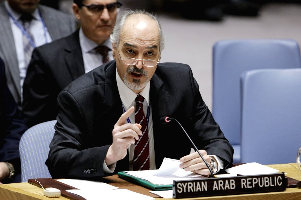 UNITED NATIONS, March 27, 2018 - Syrian Ambassador to the United Nations Bashar Ja'afari (front) addresses a United Nations Security Council meeting on the humanitarian situation in Syria, at the UN ...