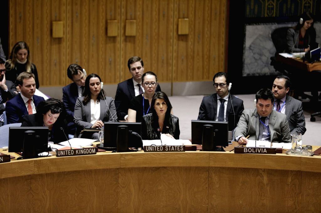 UNITED NATIONS, March 27, 2018 - U.S. Ambassador to the United Nations Nikki Haley (C, front) addresses a United Nations Security Council meeting on the humanitarian situation in Syria, at the UN ...