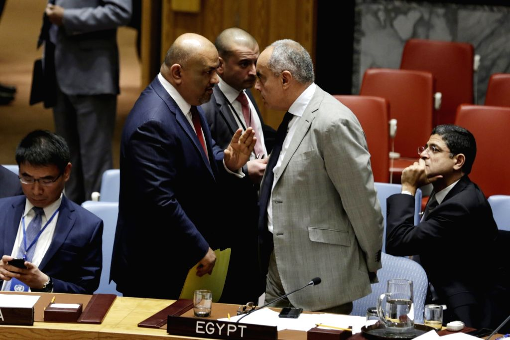 UNITED NATIONS, Nov. 1, 2016 - Khaled Hussein Mohamed Alyemany (2nd L), permanent representative of Yemen to the United Nations, talks with Amr Abdel Latif Aboulatta (2nd R), permanent representative ...