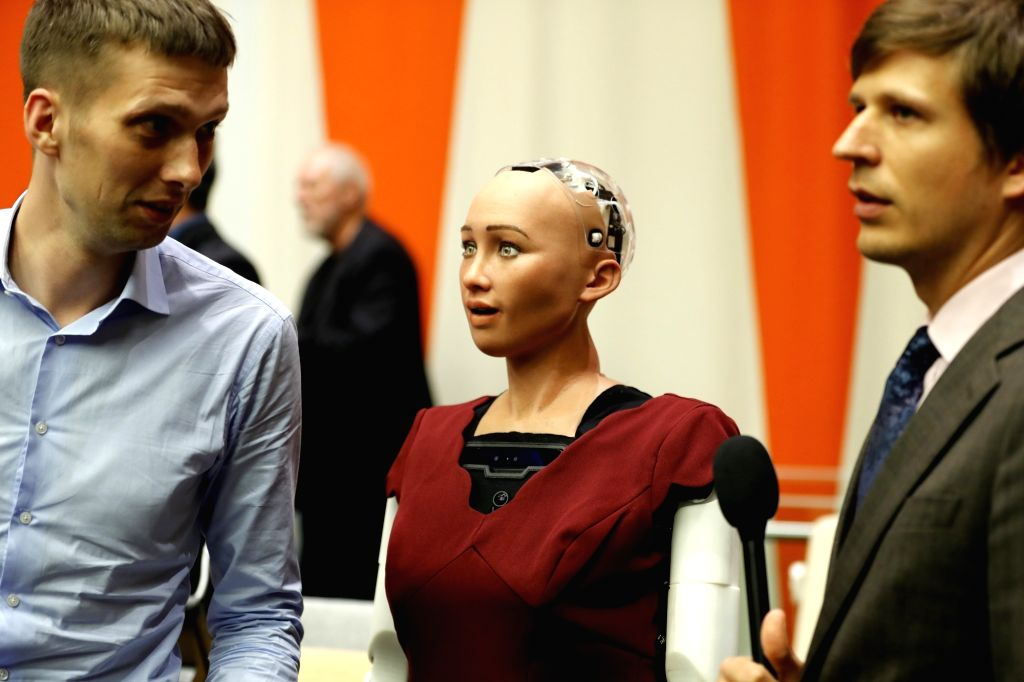 "UNITED NATIONS, Oct. 12, 2017 - Sophia (C), a life-like humanoid robot, is pictured at the UN headquarters in New York, Oct. 11, 2017. Sophia was here attending a meeting on ""The Future of ..."