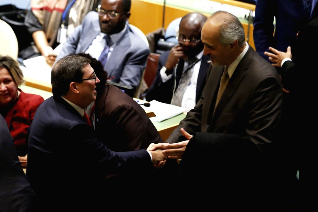UNITED NATIONS, Oct. 26, 2016 - Bashar Ja'afari(R), Syria's Permanent Representative to the United Nations, congratulates Bruno Rodriguez Parrilla(L), foreign minister of Cuba after UN General ...