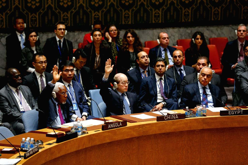 UNITED NATIONS, Oct. 8, 2016 - Liu Jieyi(C, front), Chinese Permanent Representative to the United Nations, votes to abstain a France-drafted UN Security Council resolution on Syria at the United ...