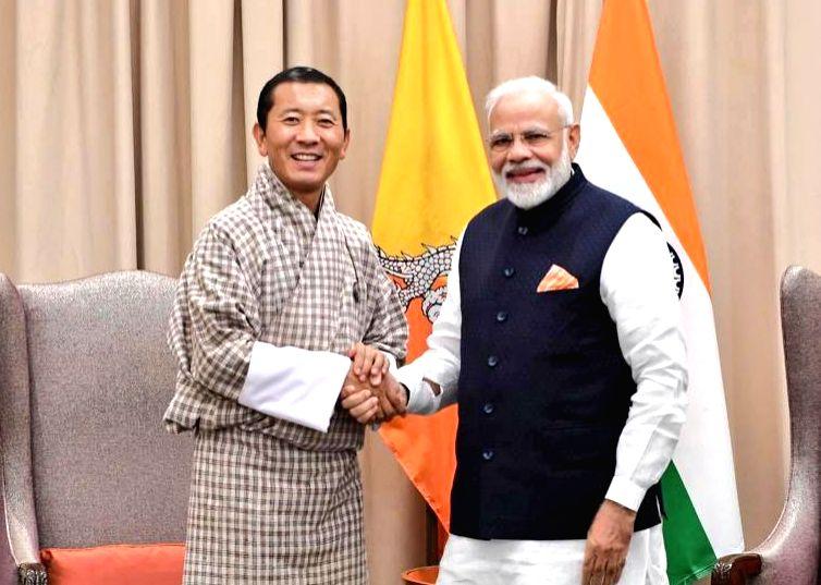 United Nations: Prime Minsiter Narendra Modi meets Bhutanese Prime Minister Lotay Tshering on the sidelines of UNGA 74 at United Nations on Sep 27, 2019. (Photo: IANS/MEA) - Lotay Tshering and Minsiter Narendra Modi