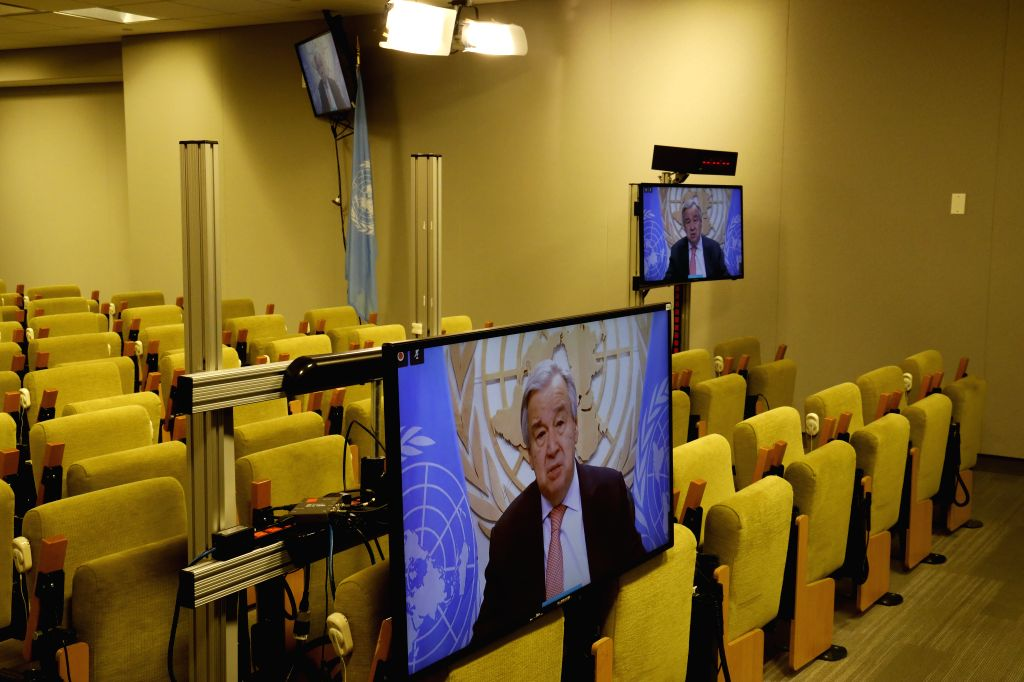 United Nations Secretary-General Antonio Guterres (on the screens) speaks at a virtual press briefing at the UN headquarters in New York, on June 25, 2020. ...