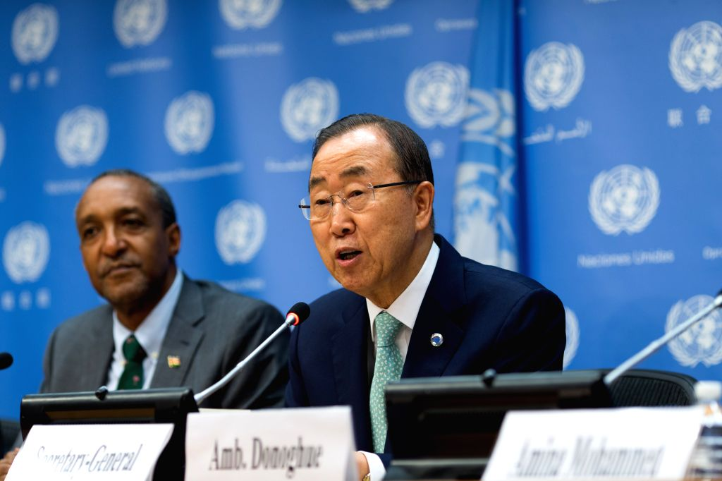 United Nations Secretary-general Ban Ki-moon (R) addresses a press conference on the Outcome Document of the Post-2015 Development Agenda at the UN headquarters in ...