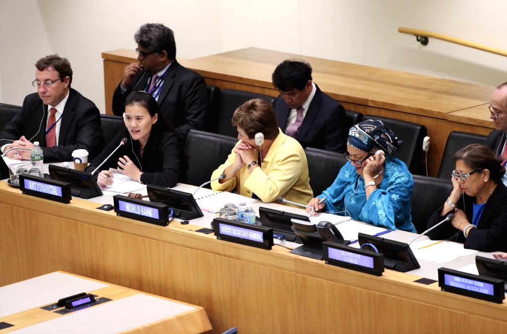 "UNITED NATIONS, Sept. 18, 2017 - Lucy Peng (2nd L, first row), the executive chair of Ant Financial, an affiliate of China's e-commerce giant Alibaba Group, speaks at a meeting on ""The Role of ..."