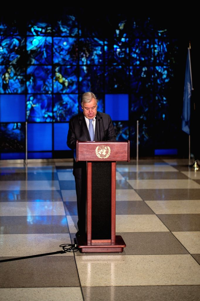 UNITED NATIONS, Sept. 18, 2018 - United Nations Secretary-General Antonio Guterres observes a minute of silence during a wreath-laying ceremony for the 57th anniversary of the death of former ...