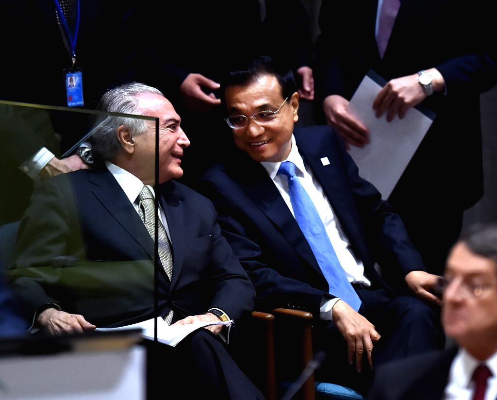 UNITED NATIONS, Sept. 19, 2016 - Chinese Premier Li Keqiang (R) and Brazilian President Michel Temer attend the Summit for Refugees and Migrants of the on-going U.N. General Assembly in New York, the ...