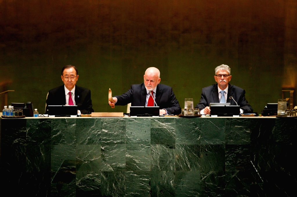 UNITED NATIONS, Sept. 19, 2016 - Peter Thomson (C), president of the 71st United Nations General Assembly, gavels to adopt a declaration on refugees and migrants during a UN summit at UN headquarters ...