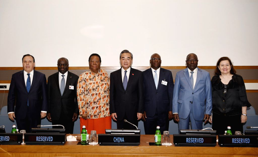 UNITED NATIONS, Sept. 26, 2019 - Chinese State Councilor and Foreign Minister Wang Yi (C) meets with the foreign ministers of Cote d'Ivoire, Equatorial Guinea and South Africamembers of the ... - Wang Y