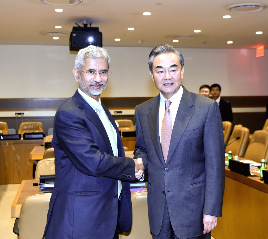 UNITED NATIONS, Sept. 26, 2019 (Xinhua) -- Chinese State Councilor and Foreign Minister Wang Yi (R) meets with Indian External Affairs Minister Subrahmanyam Jaishankar on the sidelines of the 74th session of the UN General Assembly at the UN headquar - Wang Y