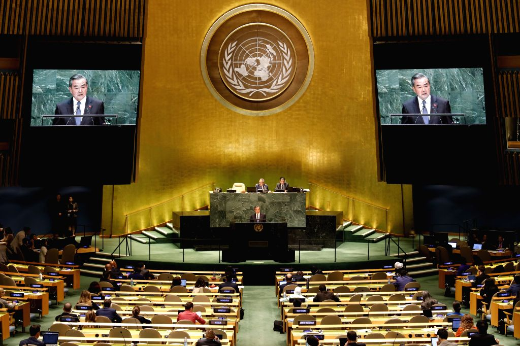 UNITED NATIONS, Sept. 27, 2019 - Chinese State Councilor and Foreign Minister Wang Yi (C) addresses the General Debate of the 74th session of the UN General Assembly at the UN headquarters in New ... - Wang Y