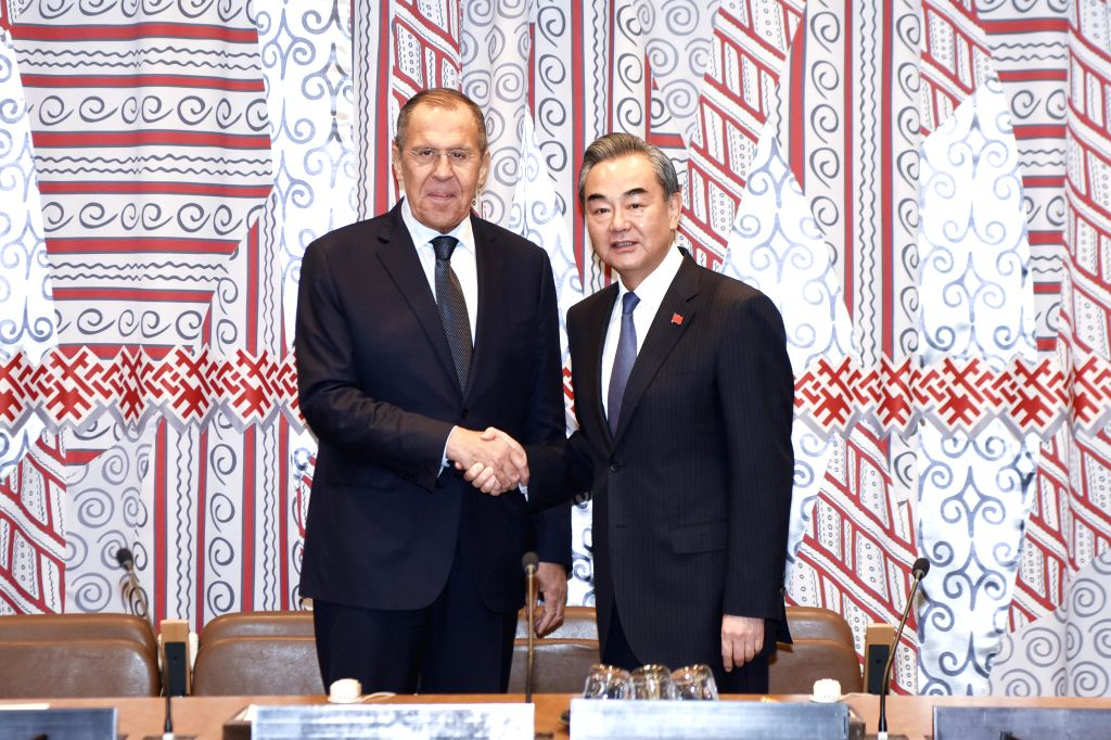 UNITED NATIONS, Sept. 27, 2019 - Chinese State Councilor and Foreign Minister Wang Yi (R) shakes hands with Russian Foreign Minister Sergei Lavrov during their meeting on the sidelines of the 74th ... - Wang Y