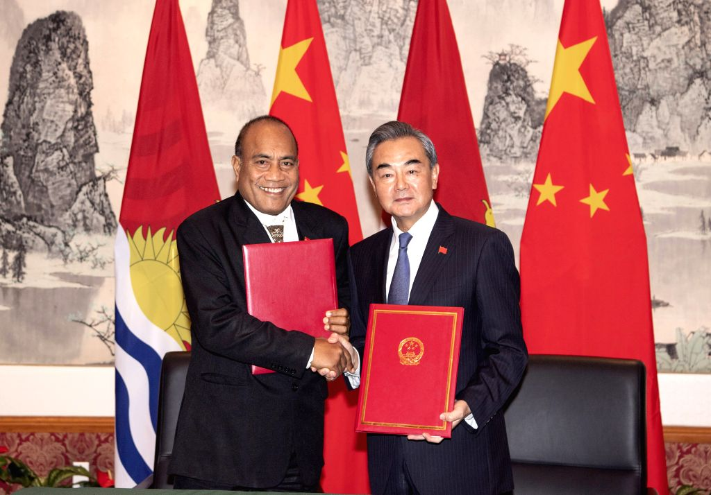 UNITED NATIONS, Sept. 28, 2019 - Chinese State Councilor and Foreign Minister Wang Yi (R) and Kiribati's President and Foreign Minister Taneti Mamau shake hands at the Chinese Permanent Mission to ... - Wang Y