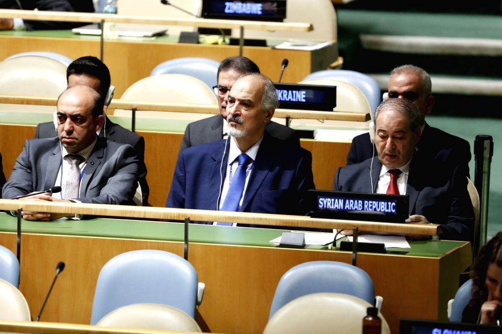 UNITED NATIONS, Sept. 28, 2019 - Syria's Deputy Foreign Minister Faisal Mekdad (R, front) and Syria's Permanent Representative to the United Nations Bashar Ja'afari (C, front) listen to Syria's ... - Faisal Mekdad