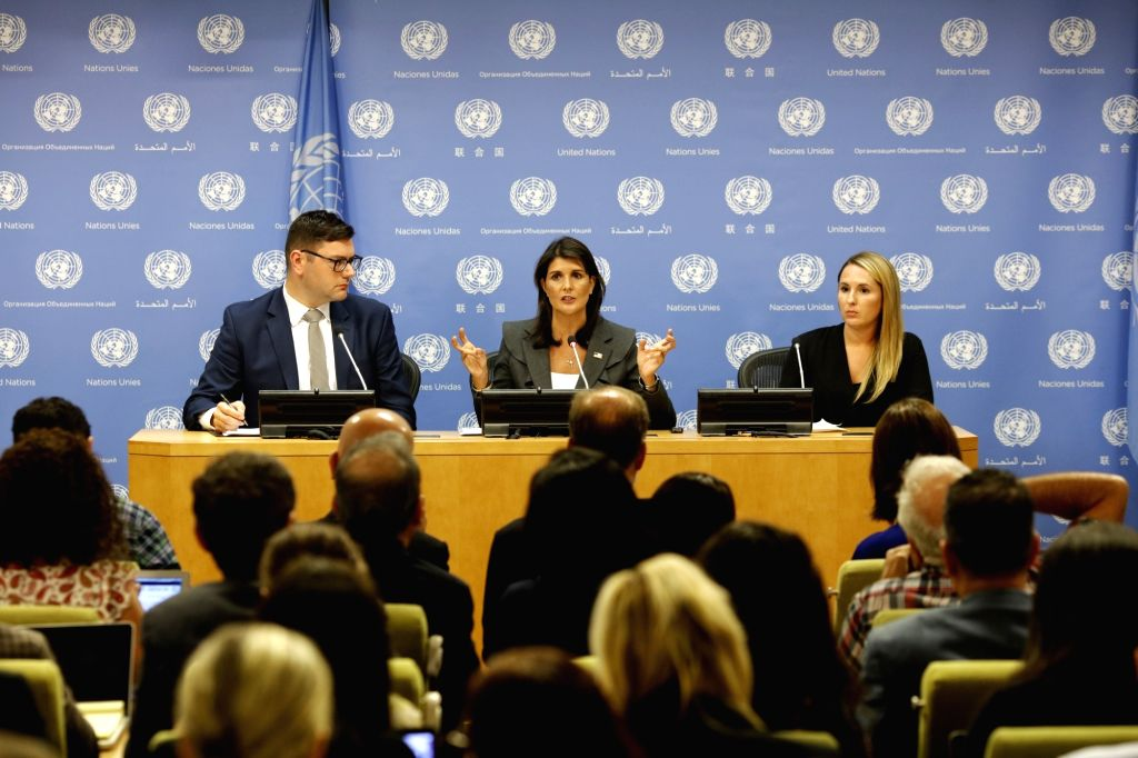 UNITED NATIONS, Sept. 4, 2018 - U.S. Ambassador to the United Nations Nikki Haley (C rear), whose country is taking over the presidency of the Security Council for September, briefs the press at the ...