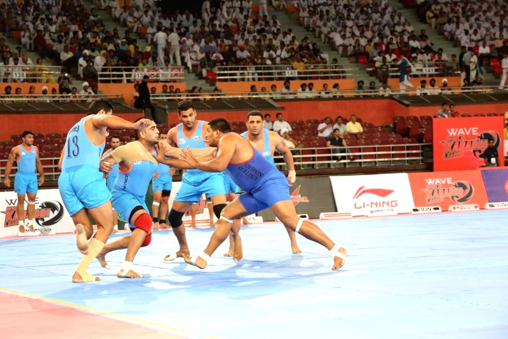 United Singhs player Ravi Kumar and Baldev of California Eagles in action during 9th match of the World Kabaddi League 2014 in New Delhi on Aug 23, 2014. - Ravi Kumar