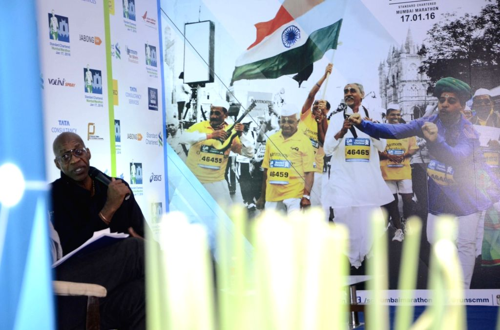 United States' legendary track and field athlete and international event ambassador of the 13th edition of the Standard Chartered Mumbai Marathon Edwin Moses addresses a press conference in ...