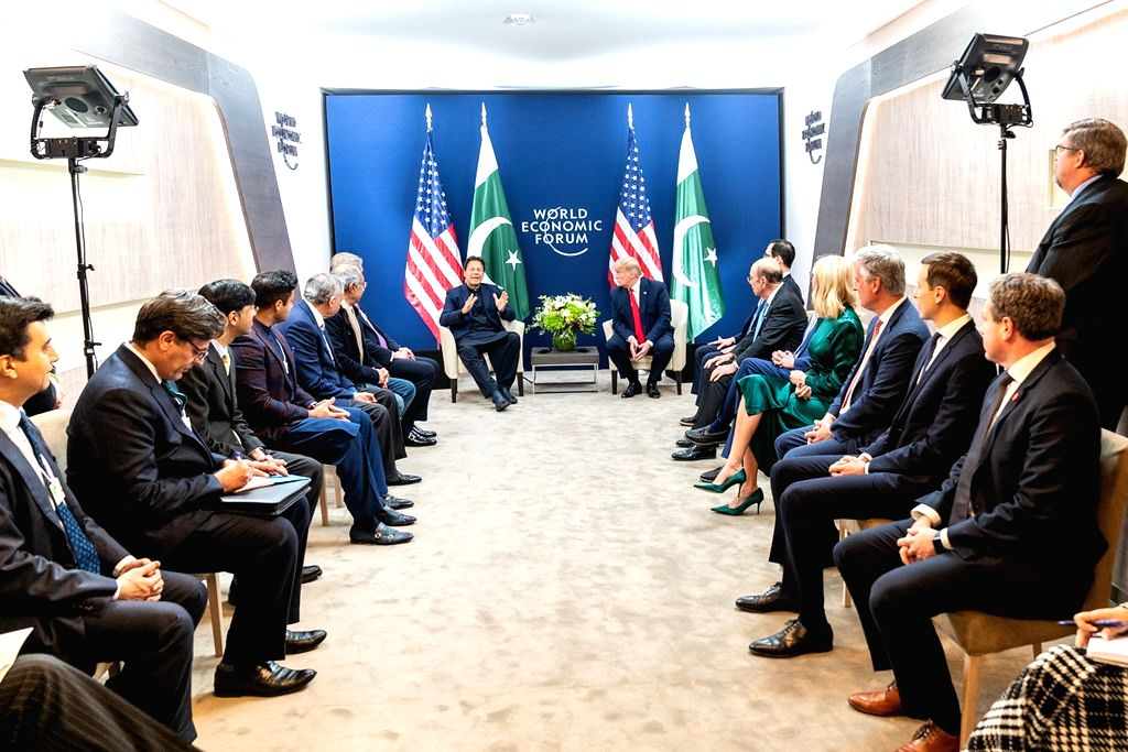 United States President Donald Trump and his officials, right, meet with Pakistan Prime Minister Imran Khan and his entourage, left, at Davos, Switzerland, on Tuesday, January 21, 2020. (Photo: White Houe/IANS) - Imran Khan