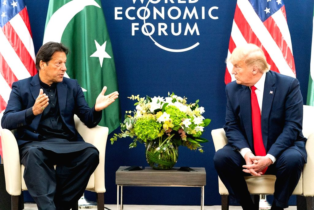 United States President Donald Trump, right, meets with Pakistan Prime Minister Imran Khan, left, at Davos, Switzerland, on Tuesday, January 21, 2020. (Photo: White Houe/IANS) - Imran Khan
