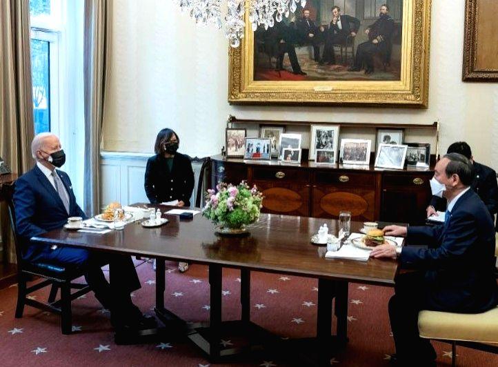 United States President Joe Biden, left, and Japanese Prime Minister Yoshihide Sugo hold talks at the White House on Friday, April 16, 2021. (Photo: White House) - Yoshihide Sugo