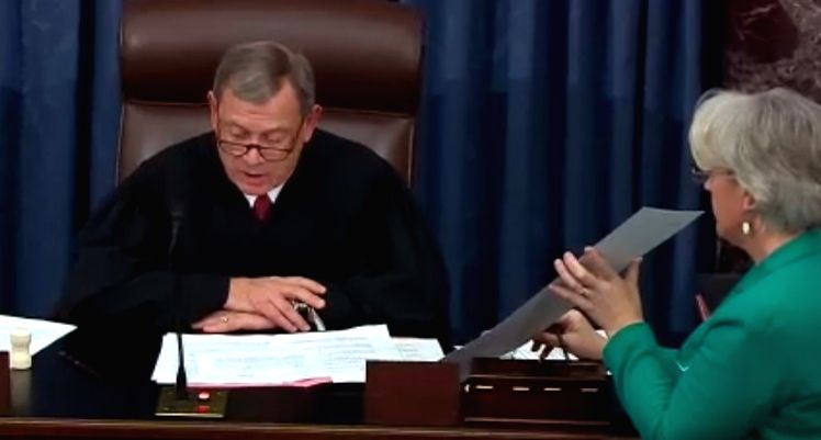 United States Supreme Court Chief Justice John Roberts, who presided over the Senate impeachment trial of President Donald Trump announces the votes tally to acquit him on Wednesday, February 5, 2020.