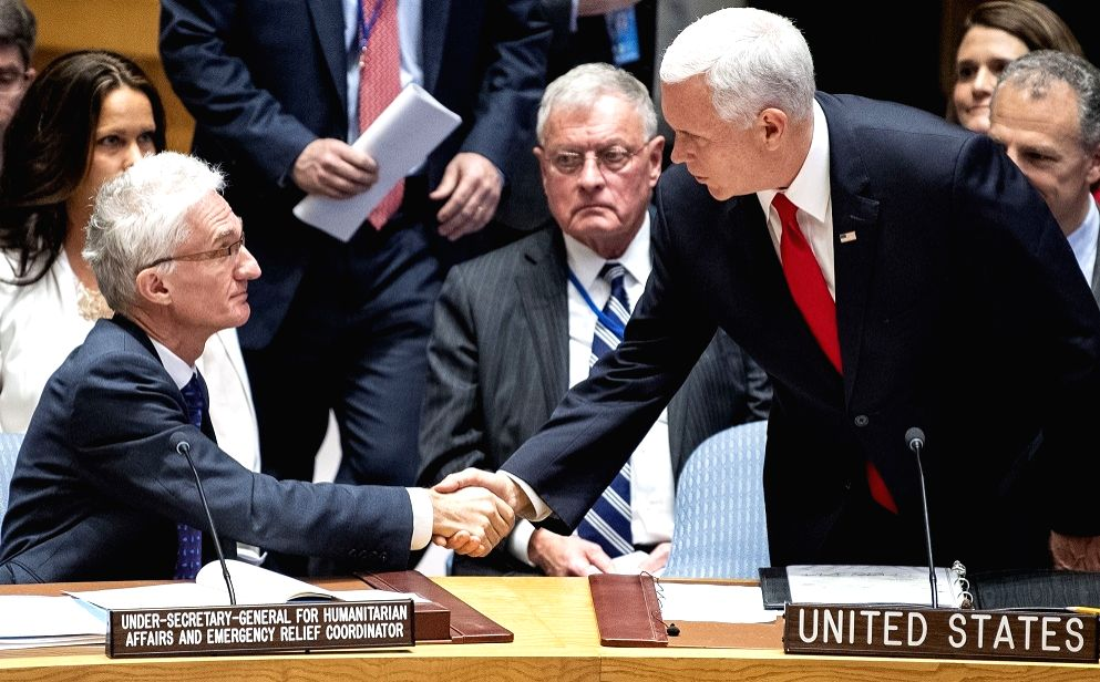 United States Vice President Mike Pence, right, greets Mark Lowcock, the United Nations Under-Secretary-General for Humanitarian Affairs, during a Security Council session on Venezuela on Wedneday, ...