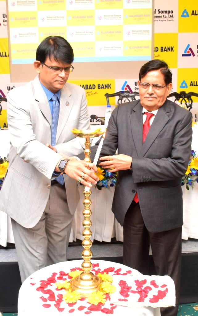 Universal Sompo General Insurance Company (USGIC) O.N. Singh, Allahabad MD and CEO S.S. Mallikarjuna Rao at the launch of the web portal of Allahabad Bank Health Care Plus Policy in Kolkata, ... - N. Singh and S. Mallikarjuna Rao