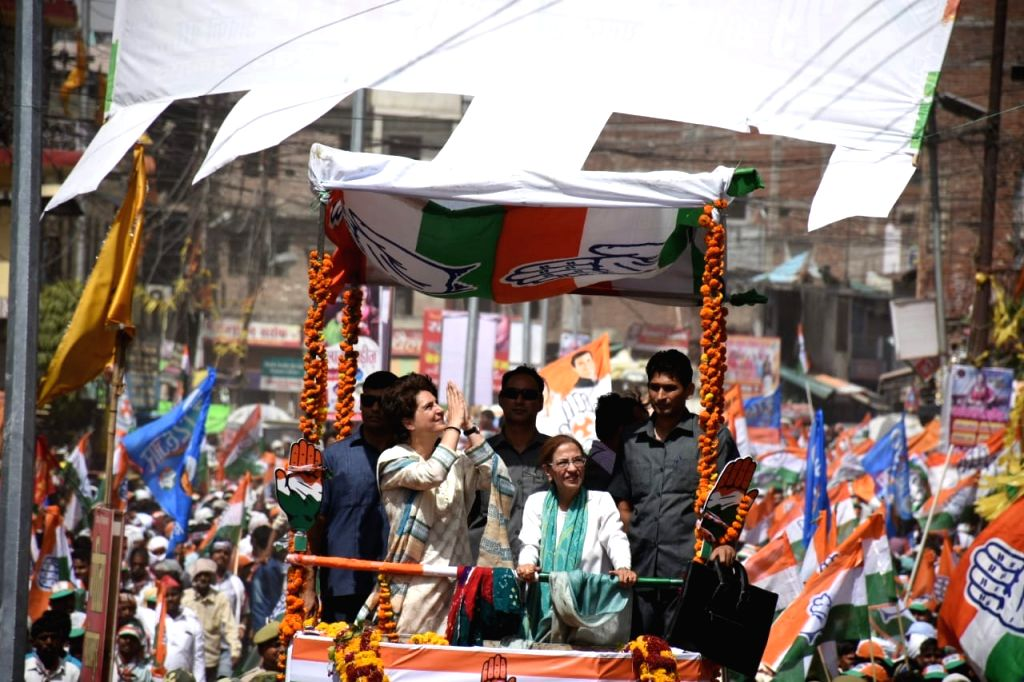 Unnao: Congress General Secretary (Uttar Pradesh East) Priyanka Gandhi Vadra with the party's candidate from Unnao during a roadshow ahead of the 2019 Lok Sabha elections, in Uttar Pradesh's Unnao on April 27, 2019. (Photo: IANS) - Priyanka Gandhi Vadra