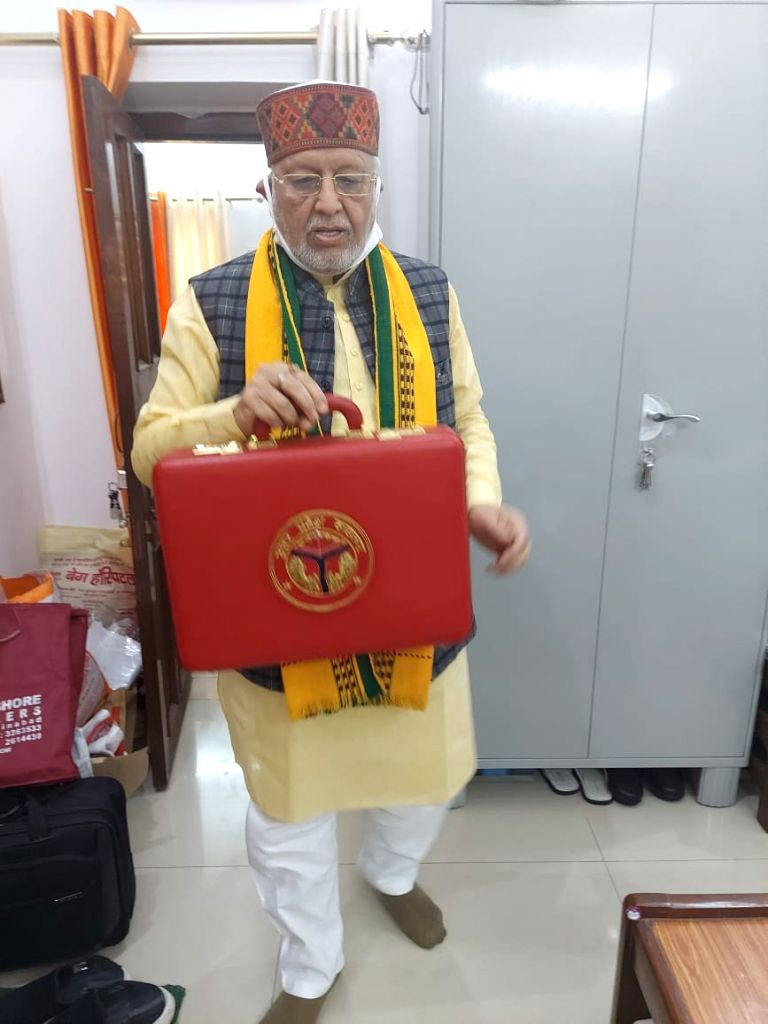 UP finance minister Suresh Khanna taking the budget. - Suresh Khanna