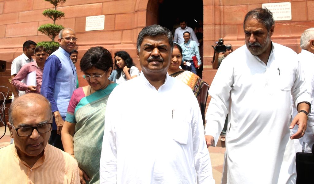 UPA candidate for Rajya Sabha Deputy Chairman's post and Congress MP from Karnataka B.K. Hariprasad (C) at Parliament, in New Delhi on Aug 8, 2018. Also seen Congress spokesperson Anand ... - Anand Sharma