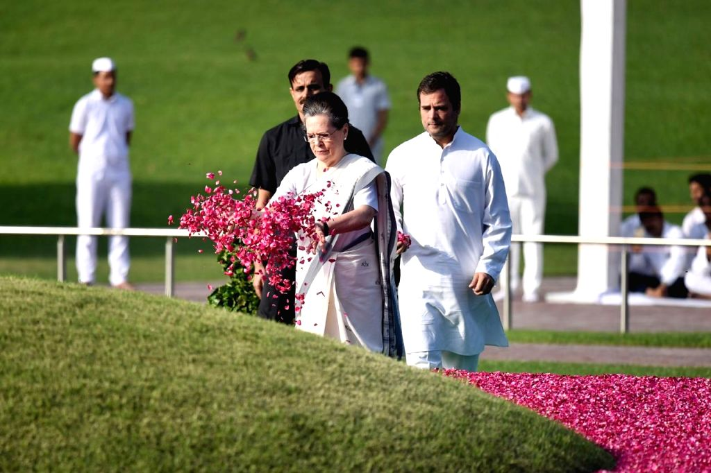 UPA Chairperson Sonia Gandhi accompanied by her son Rahul Gandhi, pays floral tributes to the country's first Prime Minister Pandit Jawaharlal Nehru on his 55th death anniversary, in New ... - Pandit Jawaharlal Nehru, Sonia Gandhi and Rahul Gandhi