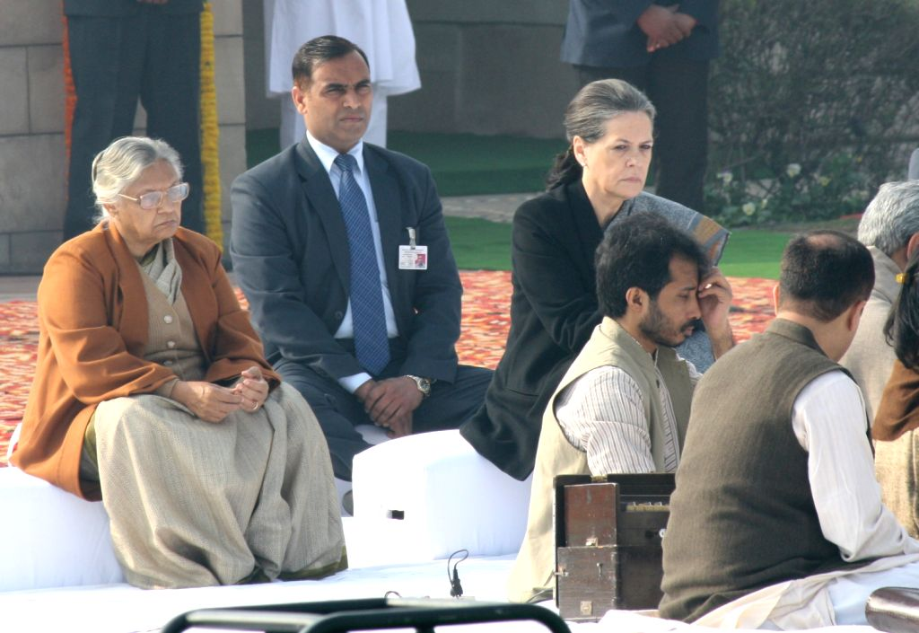 UPA Chairperson Sonia Gandhi and Delhi Chief Minister Sheila Dikshit paying tributes at the Samadhi of Mahatma Gandhi on the occasion of Martyr`s Day in Rajghat, New Delhi. - Sheila Dikshit and Sonia Gandhi