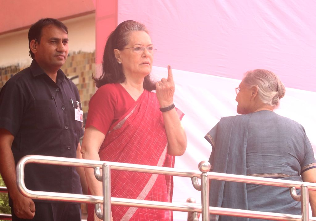UPA chairperson Sonia Gandhi shows her forefinger marked with indelible ink after casting vote during the sixth phase of 2019 Lok Sabha elections at Nirman Bhavan polling booth in New ... - Sonia Gandhi