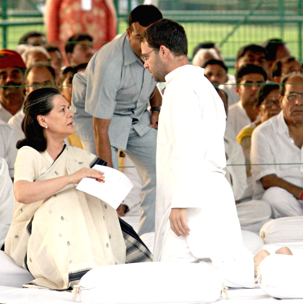 UPA Chairperson Sonia Gandhi with her son Rahul Gandhi after paying tributes to  former Prime Minister Rajiv Gandhi on his death anniversary at Vir Bhumi, in New Delhi on Thursday. (IANS: Photo)