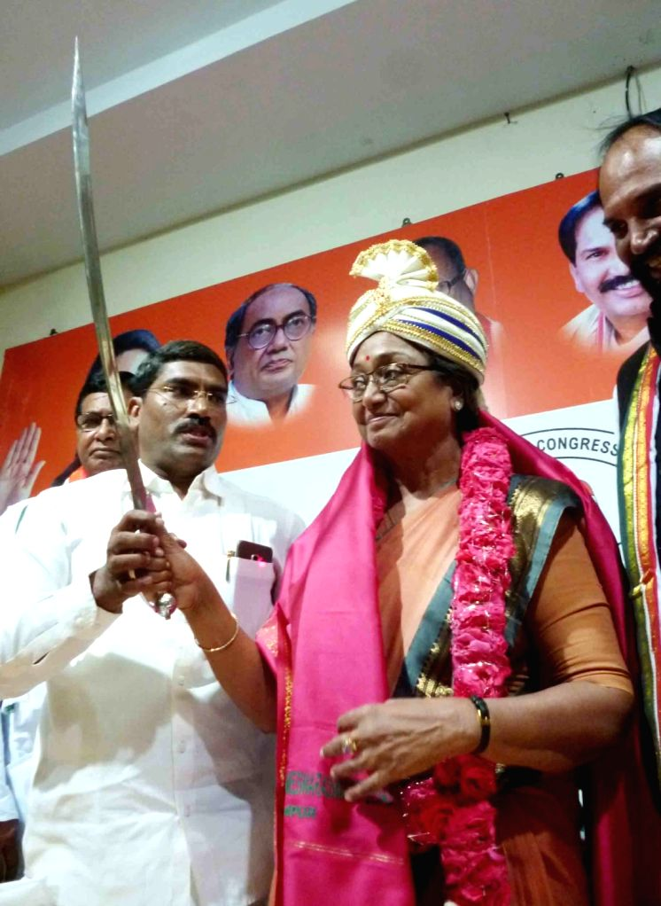 UPA's presidential candidate Meira Kumar holds a sword during a press conference at Gandhi Bhavan in Hyderabad on July 3, 2017. - Meira Kumar