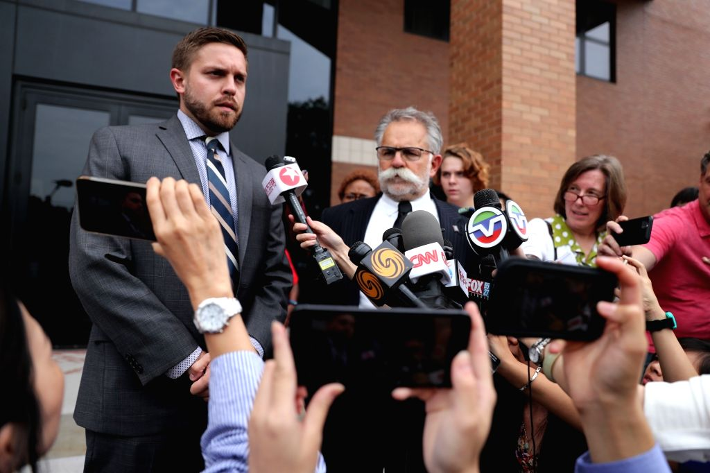 URBANA, July 6, 2017 - Brendt Christensen's attorney Evan Bruno (1st L) speaks to reporters after a hearing in Urbana, the United States, July 5, 2017. U.S. Magistrate Judge Eric Long on Wednesday ...
