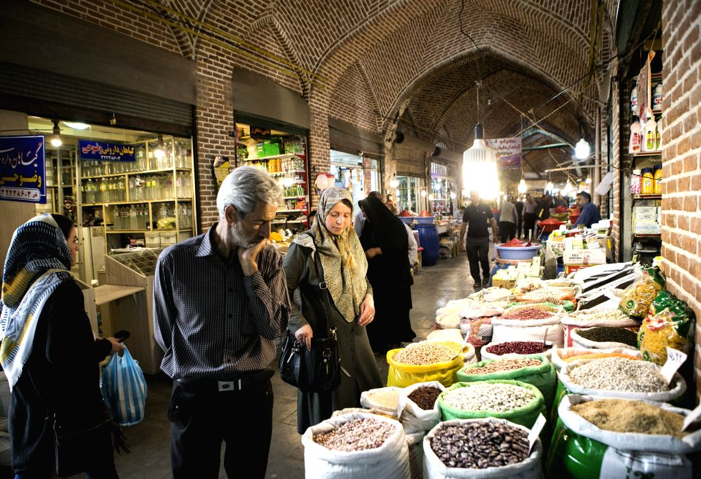 URMIA (IRAN), June 18, 2019 People shop at Urmia historical bazaar in Urmia, Iran, on June 17, 2019. Urmia historical bazaar was built hundreds of years ago and still keeps its lively ...