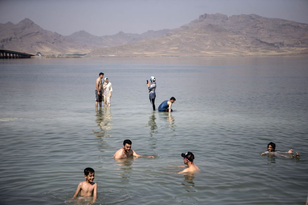 URMIA, June 18, 2019 - People enjoy themselves in the Urmia Lake in northwestern Iran on June 17, 2019. The expansion of water level of Iran's northwest Urmia Lake over the past months has attracted ...