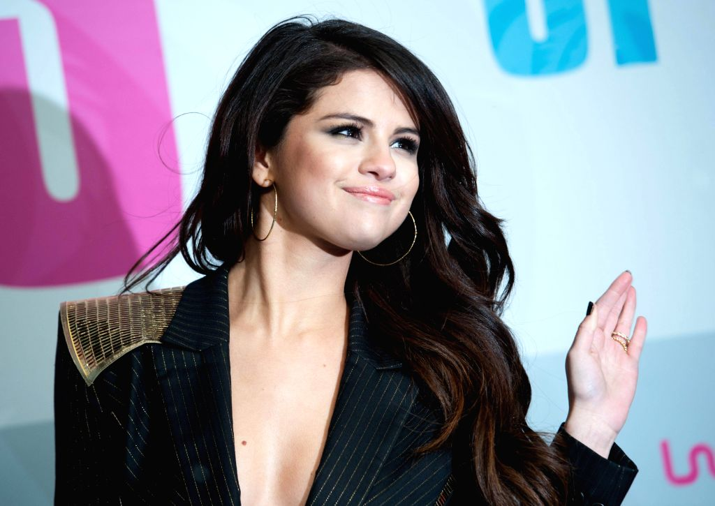 US actress Selena Gomez posing on the red carpet before the German premier of the movie Spring Breakers in Berlin, Germany, 19 February 2013. The official release day in Germany is the 21st March 2013. (Photo: dapd/IANS) - Selena Gomez