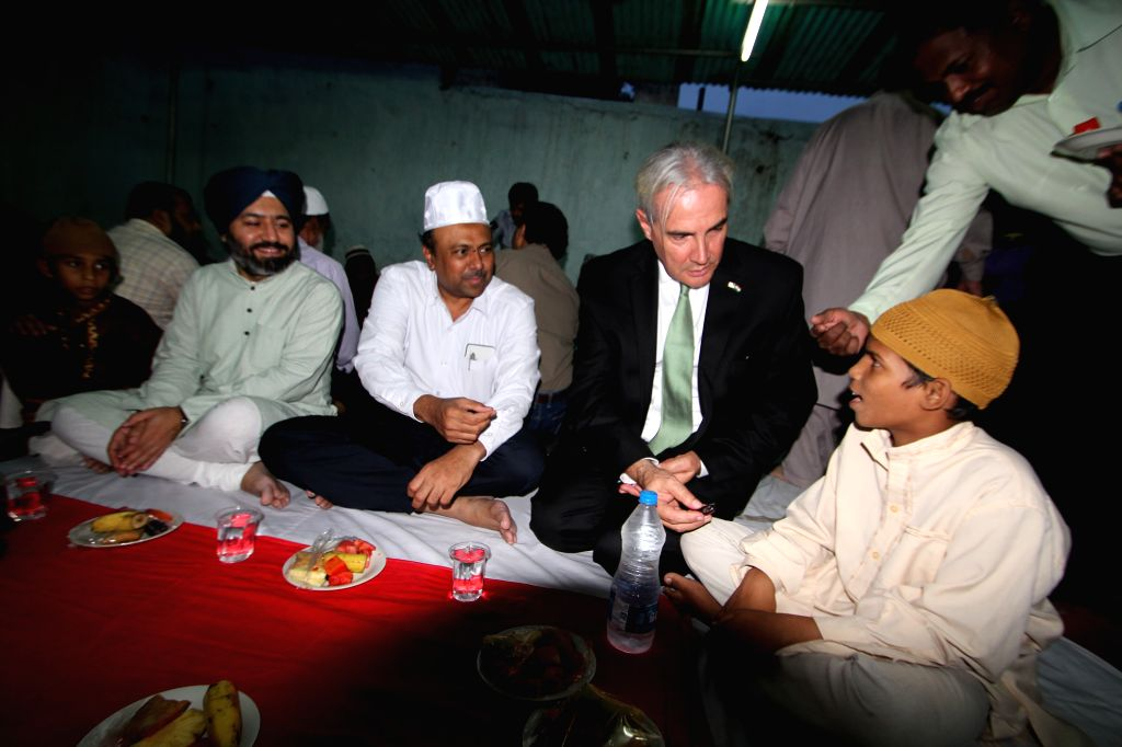 US Embassy Public Affairs Officer Gabriel Hons-Olivier visits Anees-Ul-Gurba Orphanage during an iftar party at Nampally in Hyderabad on July 10, 2015. Also seen Telangana Minorities ...