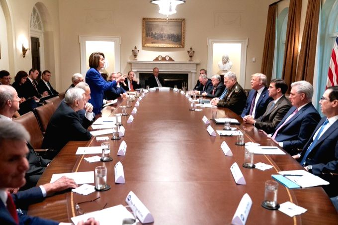 US House of Representatives Speaker Nancy Pelosi, standing at left, confronts US President Donald Trump during a White House meeting on Syria on Wednesday, October 16, 2019. The Democrats walked out ... - Nancy Pelosi
