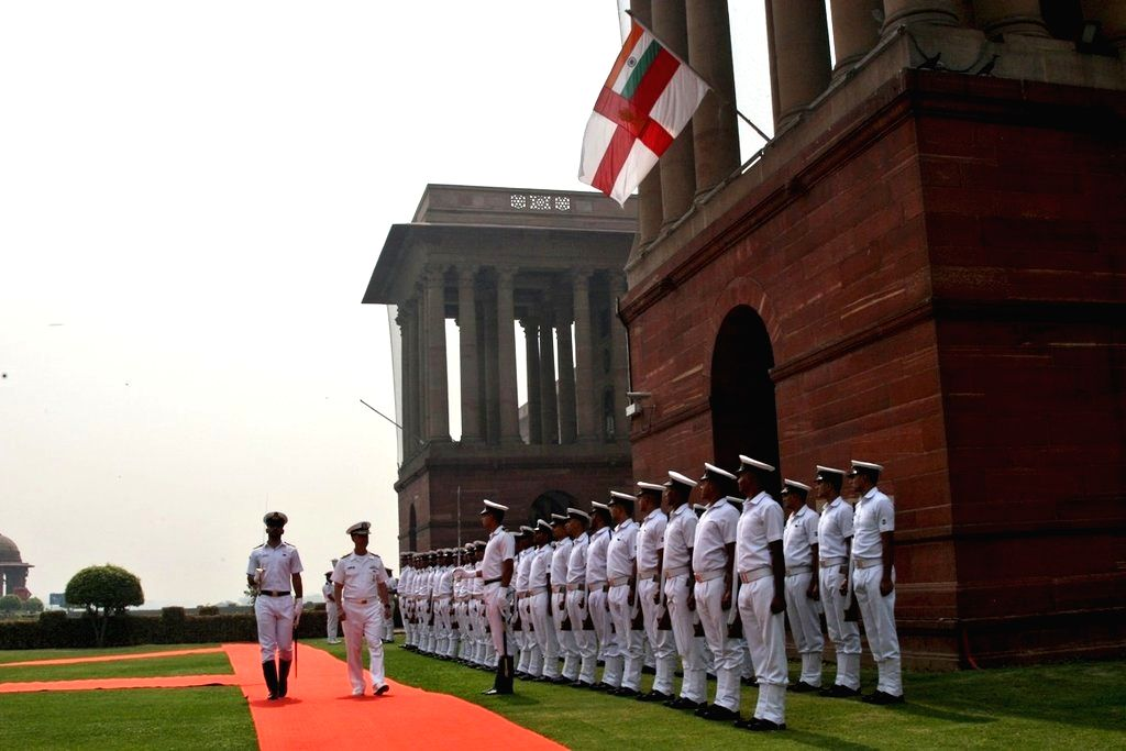 US Navy chief Admiral John Richardson inspects the Guard of Honour, in New Delhi, on May 13, 2019.