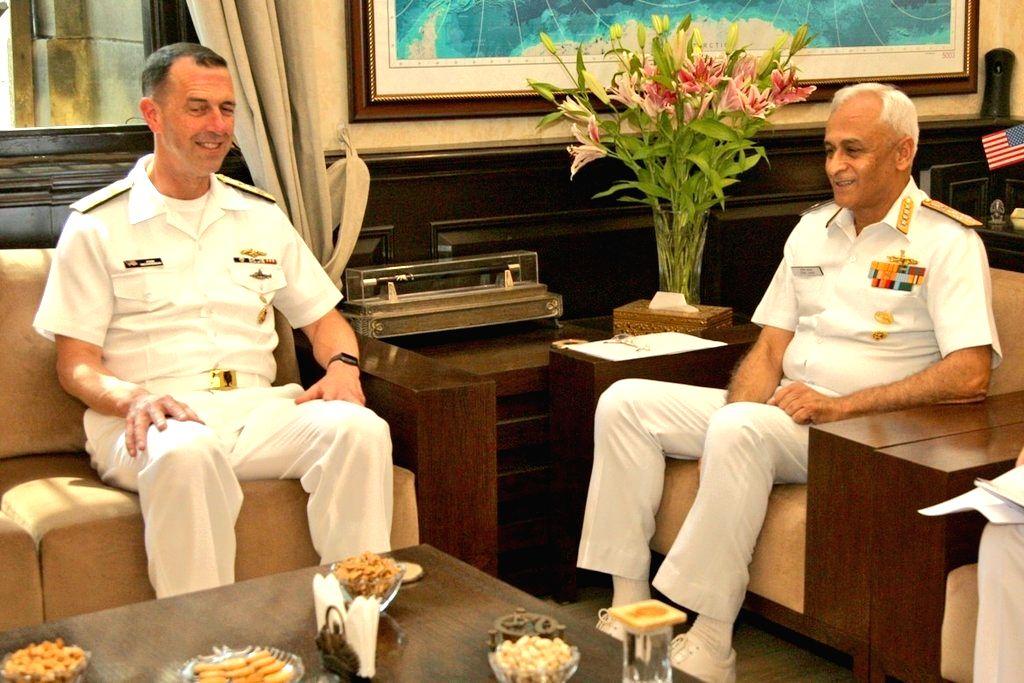 US Navy chief Admiral John Richardson meets Indian Navy chief Admiral Sunil Lanba, in New Delhi, on May 13, 2019.