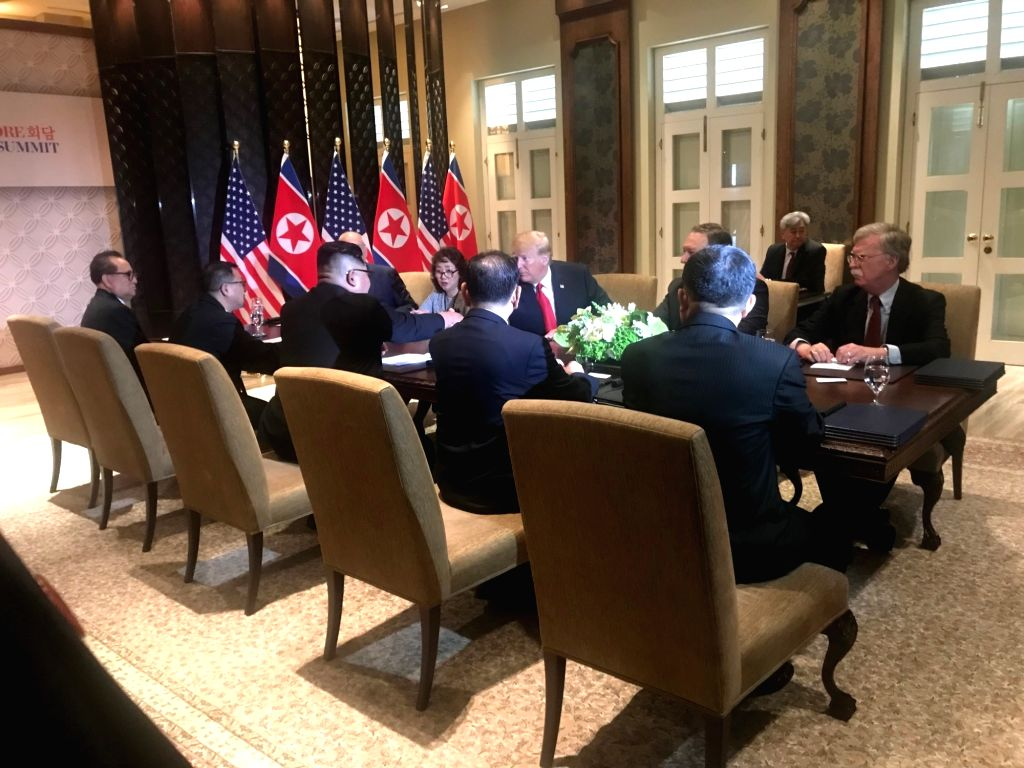 """US President Donald Trump and North Korean leader Kim Jong-un during the Singapore summit in Sentosa Island, Singapore on June 12, 2018. Kim and Trump signed a """"comprehensive"""" ..."""