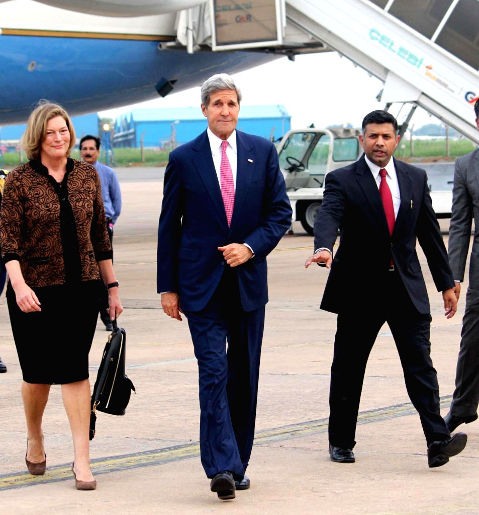 US Secretary of State John Kerry with Indian Joint Secretary (Americas) Vikram Kumar Doraiswami on his arrival at Air Force Station, Palam in New Delhi on July 30, 2014. - Vikram Kumar Doraiswami