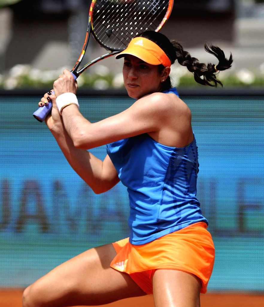US tennis player Christina McHale in action against her Russian counterpart Maria Sharapova during second round match of the WTA Madrid Open singles in Madrid, Spain on May 6, 2014. Sharapova won by .