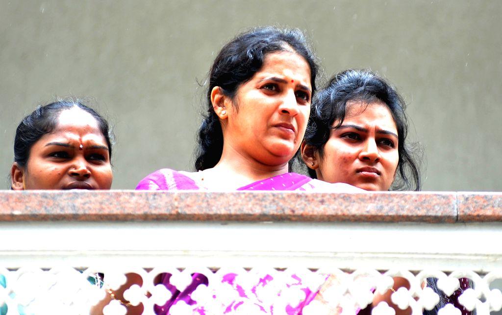 Usha Shivakumar, wife of Karnataka Power Minister D.K. Shivakumar at her residence during the Income Tax department raids in Bengaluru on Aug 4, 2017. - D.
