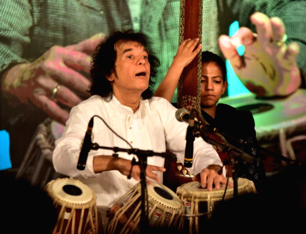 Ustad Zakir Hussain performs during a pogramme in Bhopal on March 2, 2019.